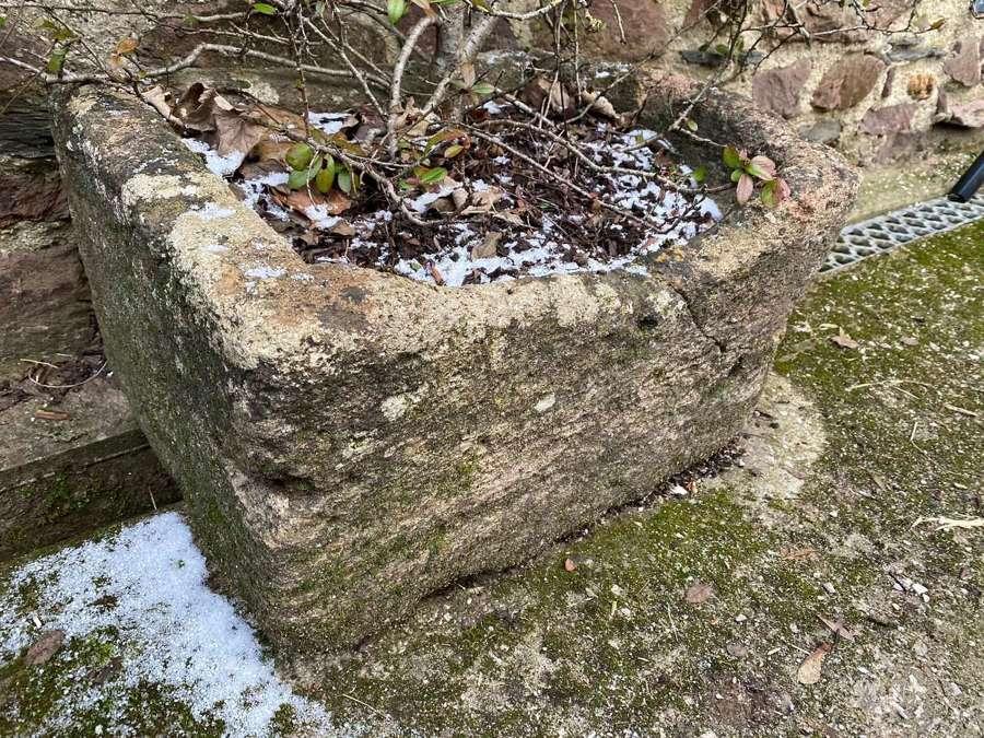 A small stone trough