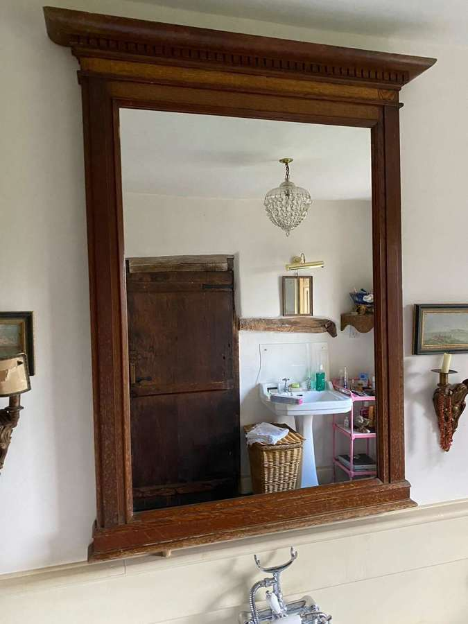 An English Oak stylised classical mirror