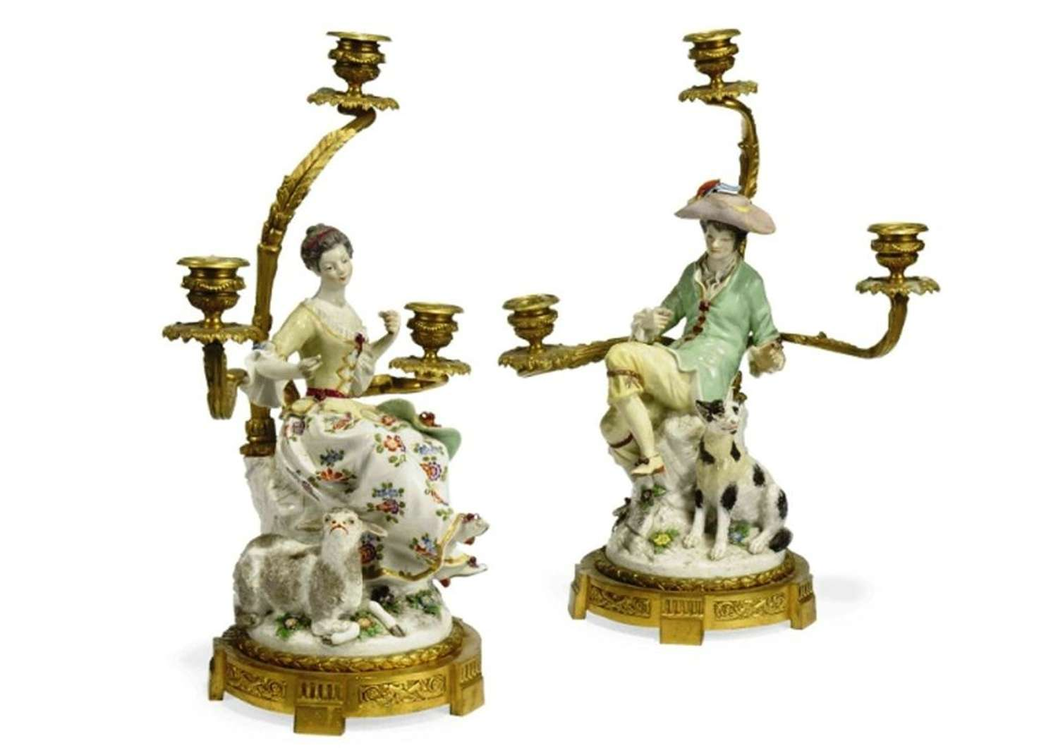 A pair of French ormolu mounted porcelain three light candelabra