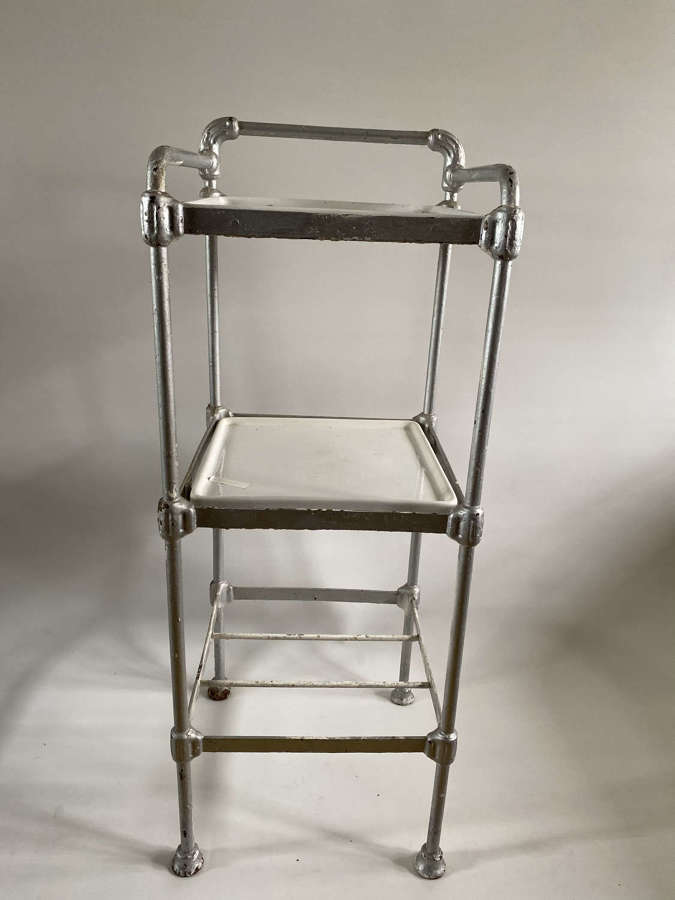 Cast iron bathroom table with porcelain shelves