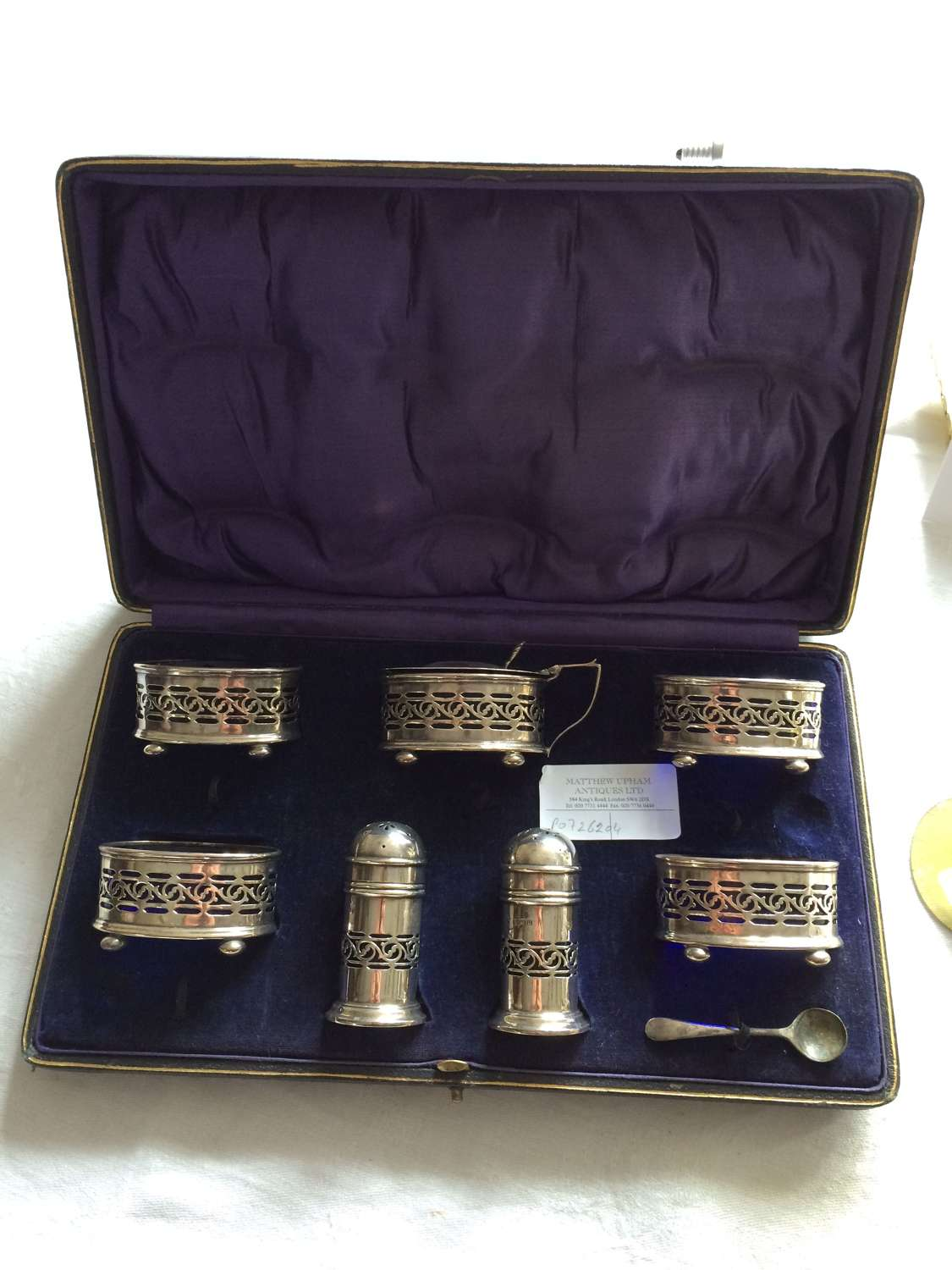 An set of silver salt and pepper holders