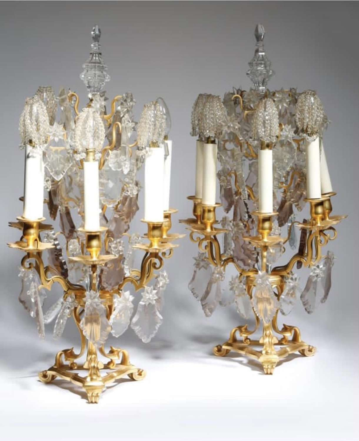 A PAIR OF GILT METAL AND GLASS FIVE-LIGHT CANDELABRA